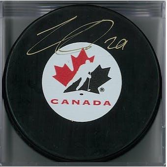 Nathan MacKinnon Autographed Team Canada Puck (Frameworth COA)