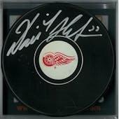 Dominik Hasek Autographed Detroit Red Wings Hockey Puck (DACW COA)