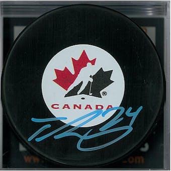 Ty Smith Autographed Team Canada Hockey Puck (DACW COA)
